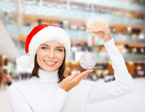 Woman in santa helper hat with christmas ball Royalty Free Stock Image