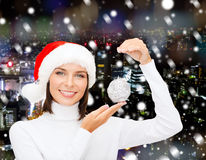 Woman in santa helper hat with christmas ball Stock Image