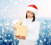 Woman in santa helper hat with gift box Stock Photo