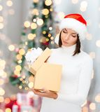 Woman in santa helper hat with gift box Royalty Free Stock Photos