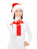 Woman in santa helper hat holding gift box Stock Photography