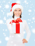 Woman in santa helper hat holding gift box Royalty Free Stock Image