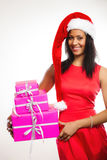 Woman santa helper hat holds gift boxes Royalty Free Stock Images