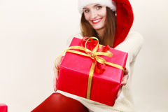 Woman in santa helper hat holds red gift box Stock Photos