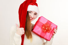 Woman in santa helper hat holds red gift box Royalty Free Stock Photo