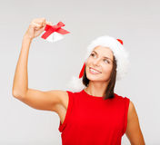 Woman in santa helper hat with jingle bells Royalty Free Stock Photo