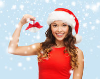 Woman in santa helper hat with jingle bells Royalty Free Stock Photos