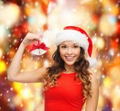Woman in santa helper hat with jingle bells Stock Photo