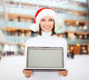 Woman in santa helper hat with laptop computer Royalty Free Stock Photography