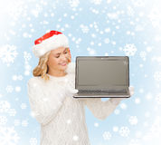 Woman in santa helper hat with laptop computer Stock Photography
