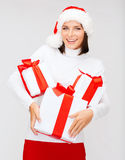 Woman in santa helper hat with many gift boxes Royalty Free Stock Photo