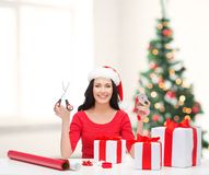 Woman in santa helper hat with many gift boxes Stock Images