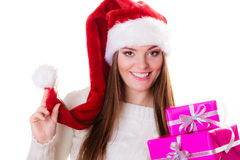 Woman santa helper hat with many pink gift boxes Stock Image