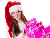 Woman santa helper hat with many pink gift boxes Royalty Free Stock Images