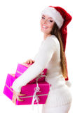Woman santa helper hat with many pink gift boxes Stock Photo