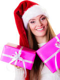 Woman santa helper hat with many pink gift boxes Stock Images