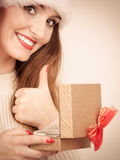 Woman in santa helper hat opening gift box Royalty Free Stock Photo