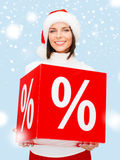 Woman in santa helper hat with percent sign Stock Photo