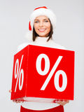 Woman in santa helper hat with percent sign Stock Image