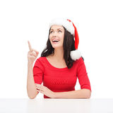 Woman in santa helper hat pointing to something Stock Image