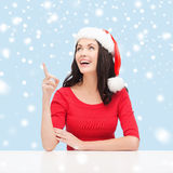 Woman in santa helper hat pointing to something Royalty Free Stock Photo