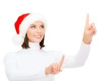 Woman in santa helper hat pressing vitrual button Stock Photography