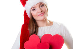 Woman in santa helper hat with red boxes Stock Image