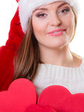 Woman in santa helper hat with red boxes Royalty Free Stock Image