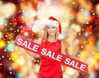Woman in santa helper hat with red sale sign Stock Images