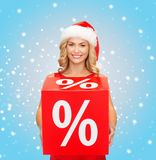 Woman in santa helper hat with red sale sign Stock Image
