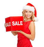 Woman in santa helper hat with red sale sign Royalty Free Stock Photography