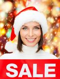 Woman in santa helper hat with red sale sign Royalty Free Stock Photos