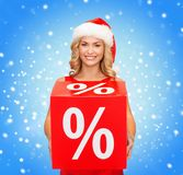 Woman in santa helper hat with red sale sign Royalty Free Stock Images