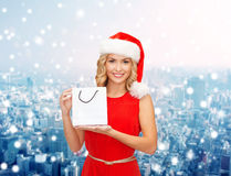Woman in santa helper hat with shopping bag Stock Image