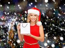 Woman in santa helper hat with shopping bag Royalty Free Stock Photo