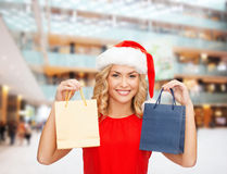 Woman in santa helper hat with shopping bags Royalty Free Stock Photo