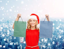 Woman in santa helper hat with shopping bags Royalty Free Stock Photography