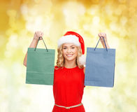 Woman in santa helper hat with shopping bags Stock Image