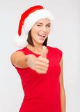 Woman in santa helper hat showing thumbs up Royalty Free Stock Photos