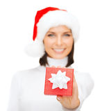 Woman in santa helper hat with small gift box Stock Image