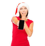 Woman in santa helper hat with smartphone Stock Images