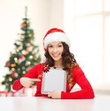 Woman in santa helper hat with tablet pc Stock Images
