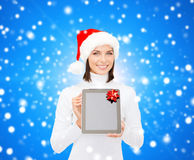 Woman in santa helper hat with tablet pc Stock Image
