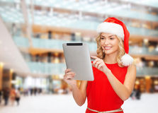 Woman in santa helper hat with tablet pc Royalty Free Stock Photo