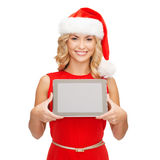 Woman in santa helper hat with tablet pc Stock Photography