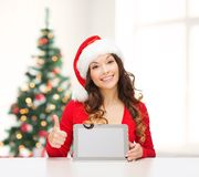 Woman in santa helper hat with tablet pc Royalty Free Stock Photos