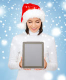 Woman in santa helper hat with tablet pc Royalty Free Stock Images