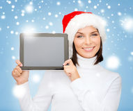 Woman in santa helper hat with tablet pc Stock Photo