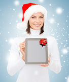 Woman in santa helper hat with tablet pc Stock Photos
