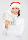 Woman in santa helper hat with us dollar money. Christmas, x-mas, sale, banking concept - smiling woman in santa helper hat with us dollar money Stock Image